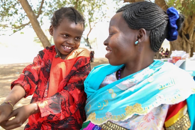 Perinah Joseph Santino with her mother Antoinette Hassan at a mobile clinic in Ngonjeko village, Wau